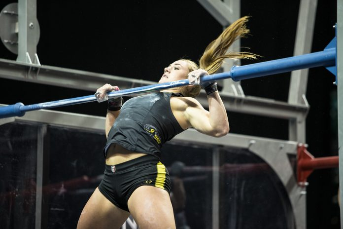 Brooke Wells of the Miami Surge completing chest-to-bar pull-ups during NPGL match