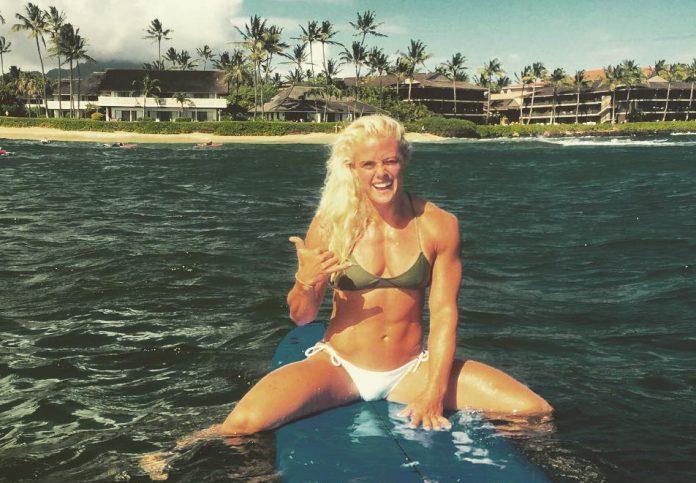 Sara Sigmundsdottir on surfboard