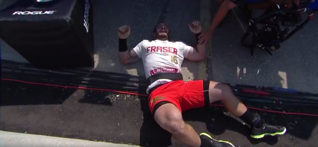 Mat Fraser after falling off the field during Strongman's Fear at the 2017 CrossFit Games.