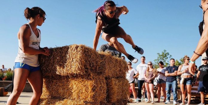 Demo Team Member showing the hay bale burpees. @thedavecastro/Instagram
