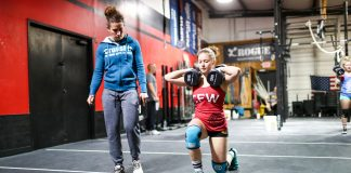 Woman performs Open Workout 17.2 in front of a judge at a CrossFit affiliate. Photo courtesy of CrossFit Inc.