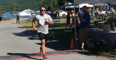 Mat Fraser running during the 2018 Basin Harbor Sprint Triathlon (photo via Instagram - @mathewfras)