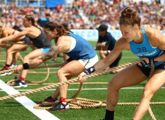 Carol-Ann Reason-Thibault and Bethany Shadburne during Two-Stroke Pull at the 2018 CrossFit Games. Photo courtesy of CrossFit Inc.
