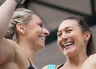 Cassidy Lance-McWherter and Jen Smith team up at the 2018 Wodapalooza Fitness Festival.