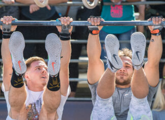 Noah Ohlsen and Will Moorad doing toes-to-bar at Wodapalooza. Photo courtesy of @FLSportsGuy